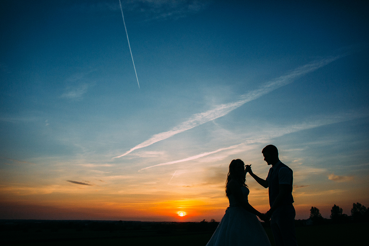 Bride and groom in the sunset at West Tower - © Lawson Photography