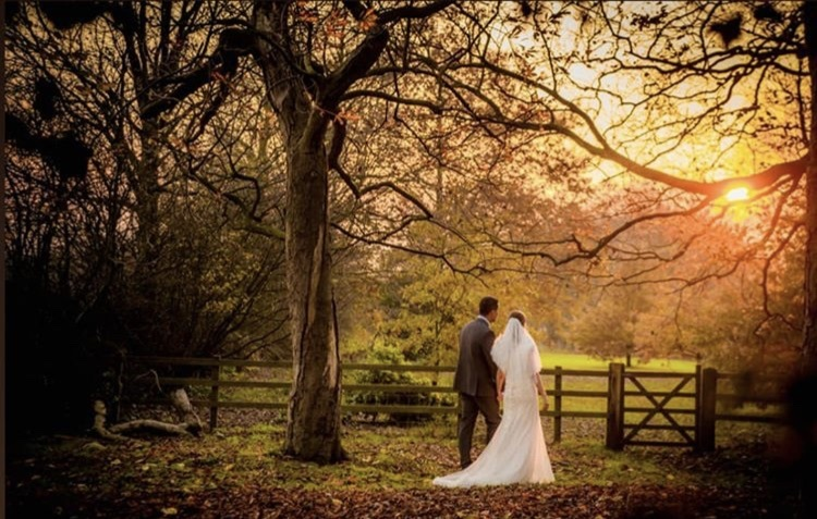 Bride & Groom in secret meadow at West Tower in autumn sunshine