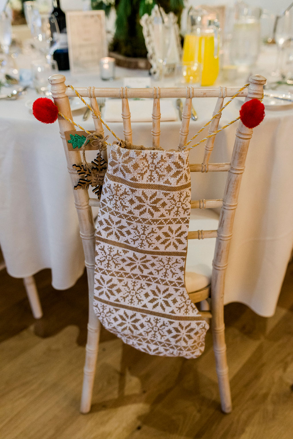 Christmas stocking hanging on a chair as childs wedding favour