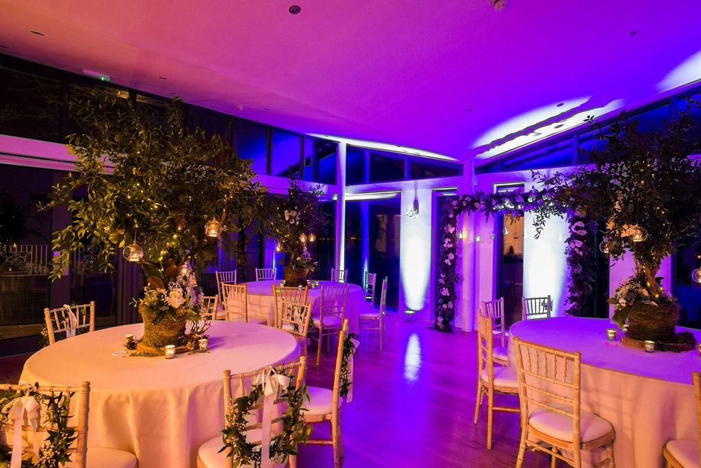 Magicel evening set-up of wedding at West Tower with purple upllighting
