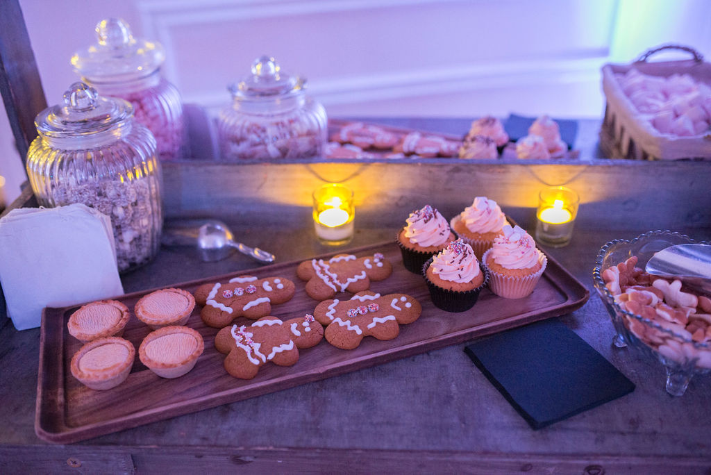Selection of gingerbread men, mince pies and cupcakes on evening dessert table at West Tower