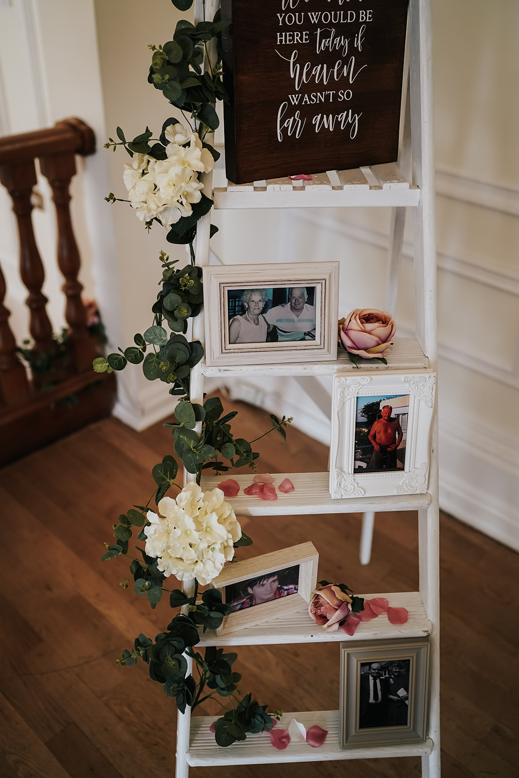 Step ladder at West Tower with photos of absent family and friends