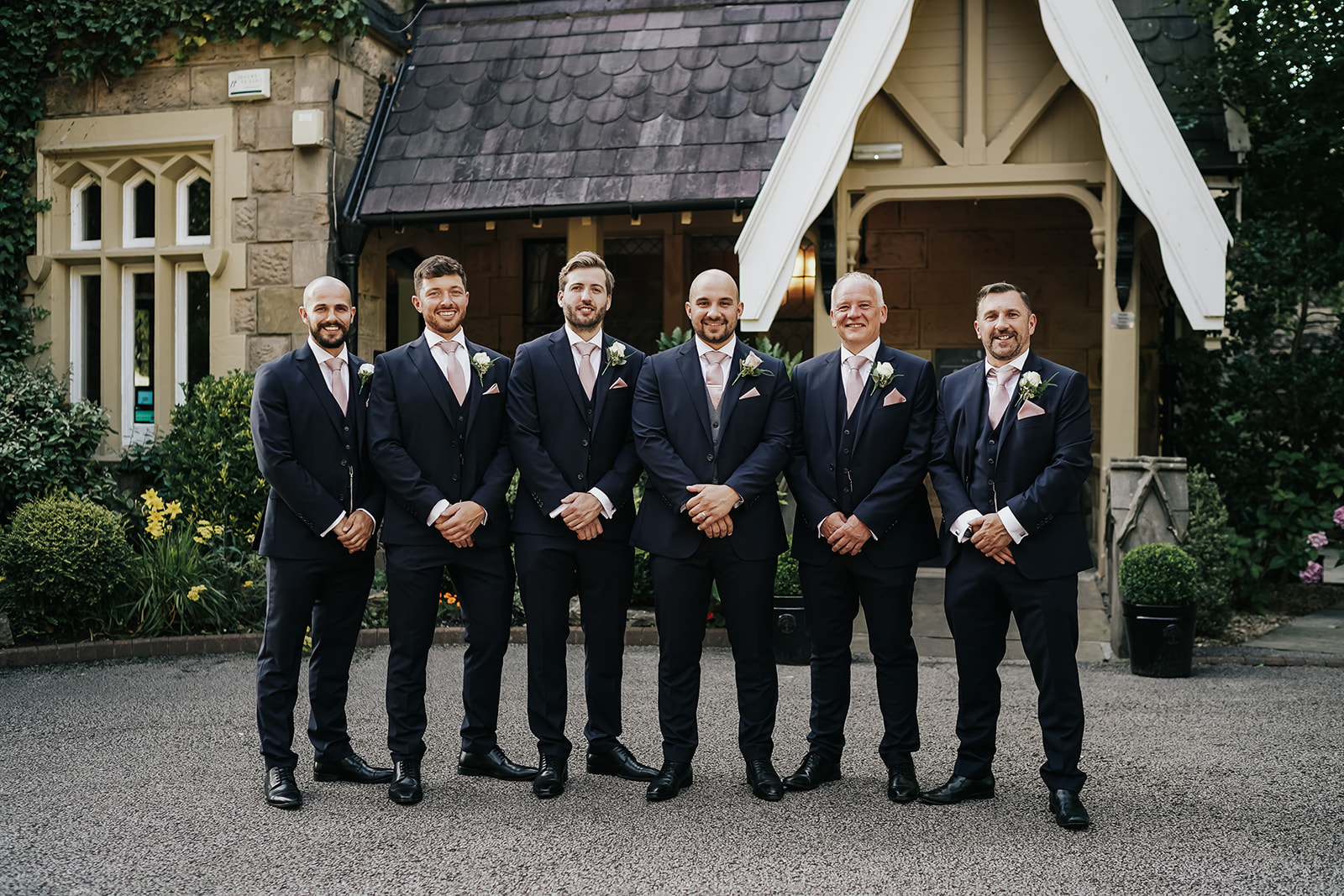 Groom and groomsmen infront of West Tower