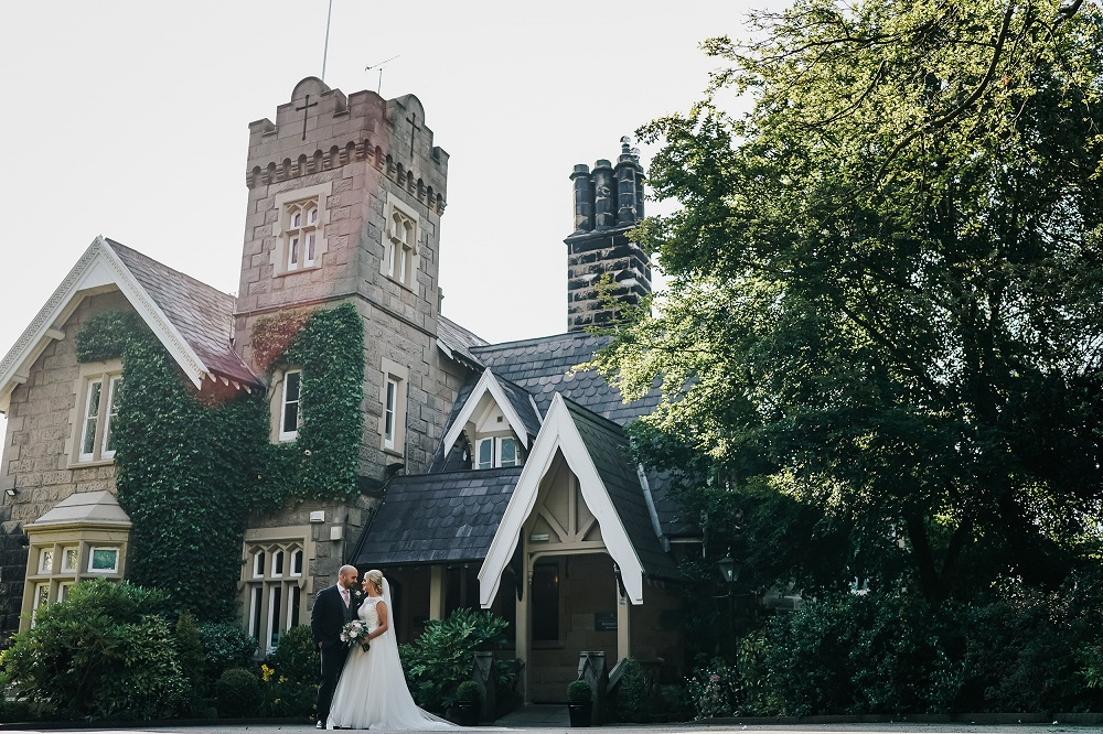 Summer Bride and Groom in front of West Tower