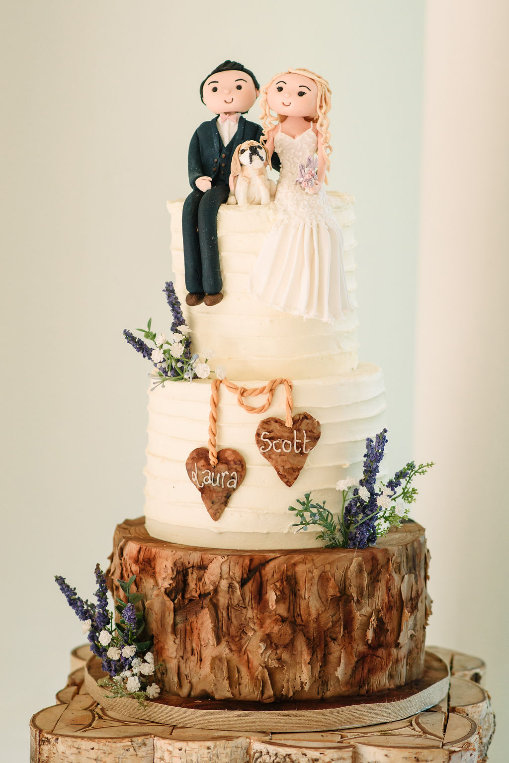 Wedding cake with bride, groom and their beagle for their spring wedding