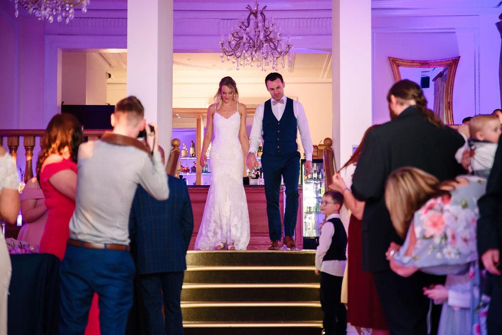 Bride & groom starting their evening spring wedding reception at West tower