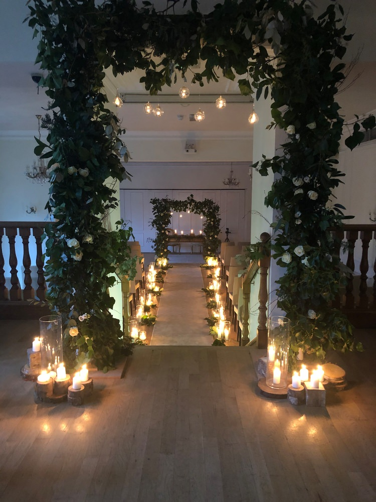 Archway & candlelit aisle at West Tower