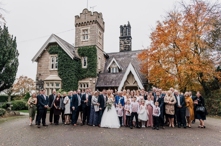 Bride & groom & bridal party in front of West Tower at their autumn wedding