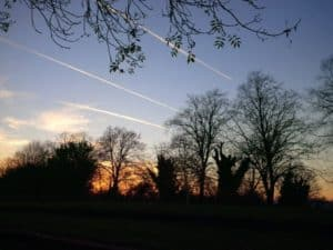 planes at sunset viewed from thames crescent
