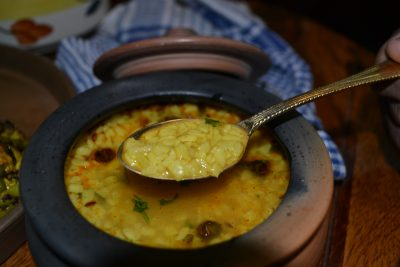 Clay Pot slow cooked Urad Daal served with Bathua Parantha