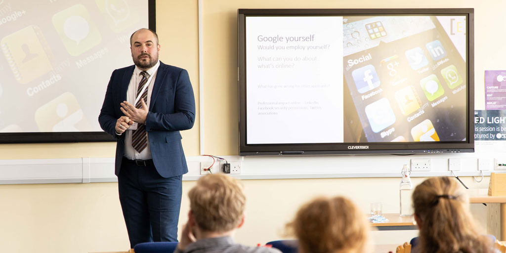 Jordan Canter deliveirng a lecture at Plymouth Marjon University