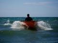skiff-surfing