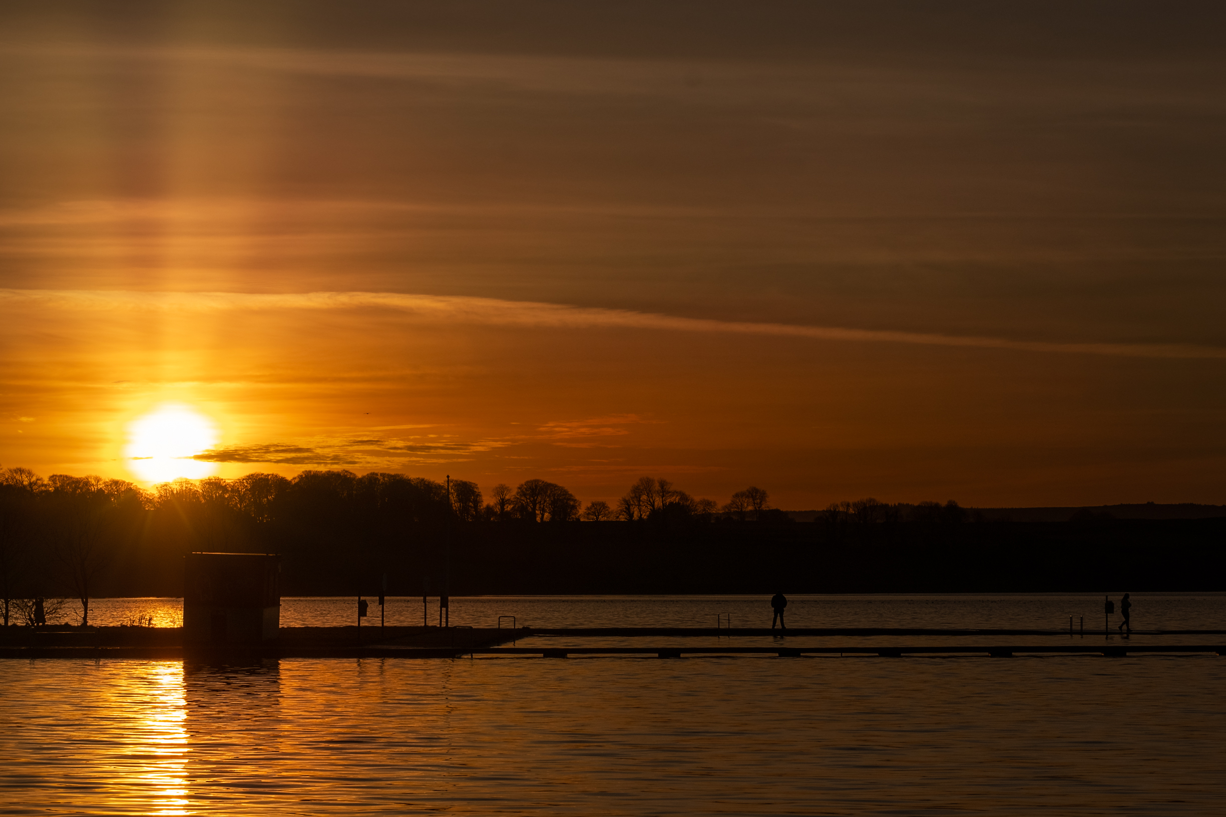 Man on Pier waiting for sunset at Loughrea Lake