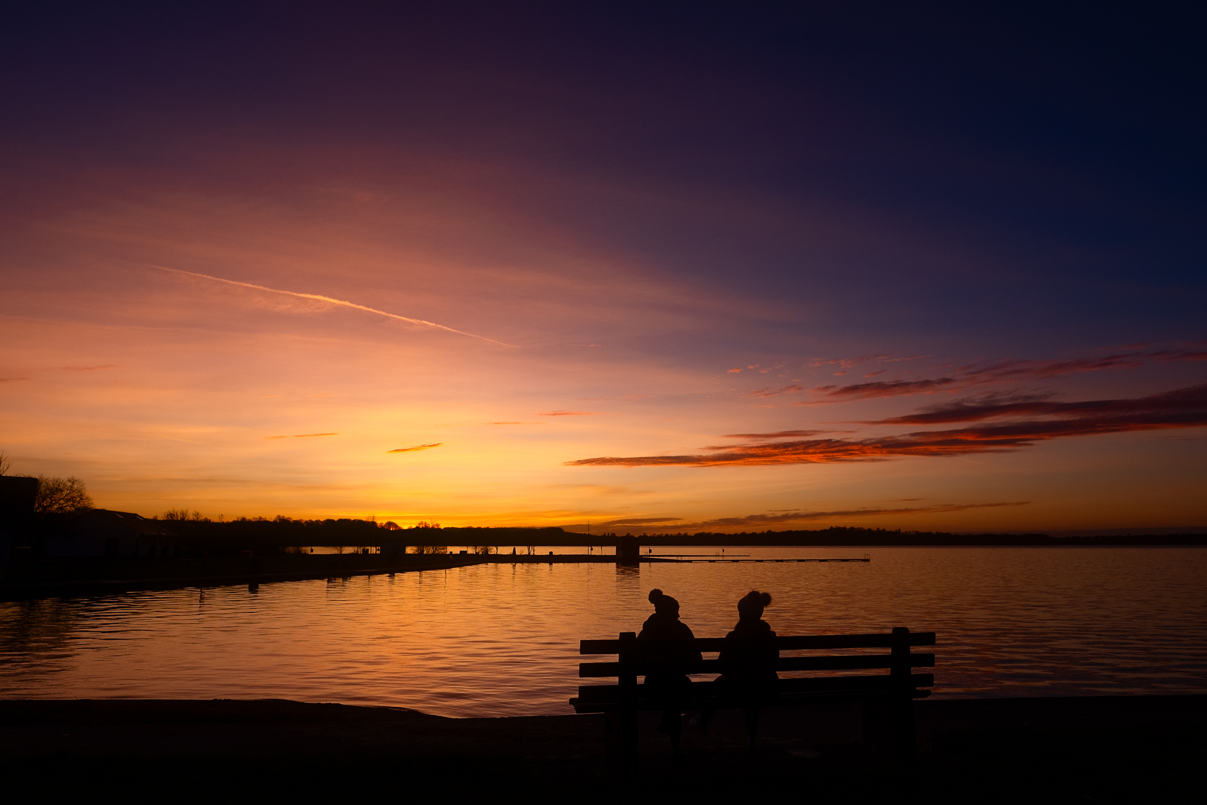 Two friends waiting on sunset Loughrea Lake