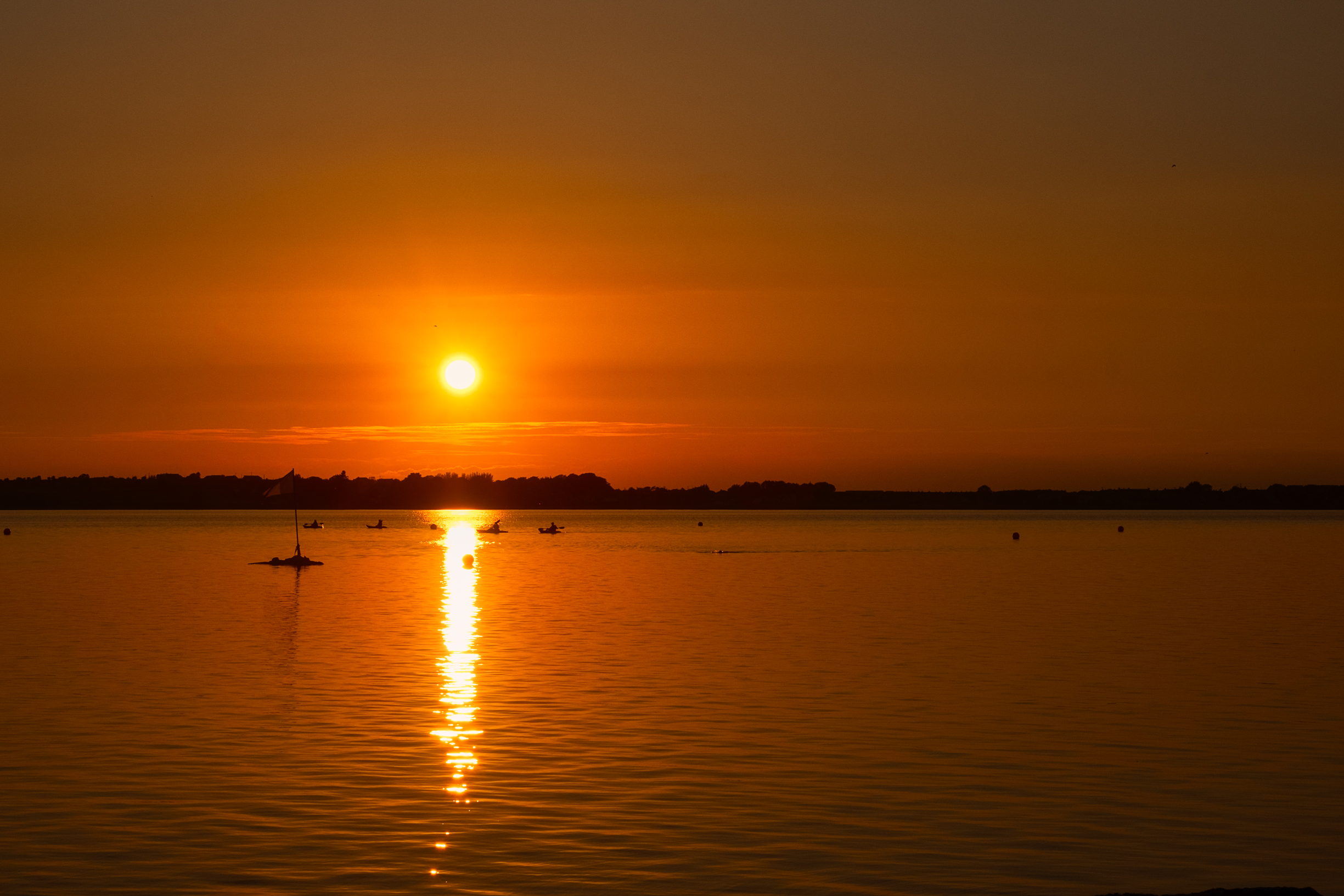 Two paddlers paddling at Sunset Loughrea