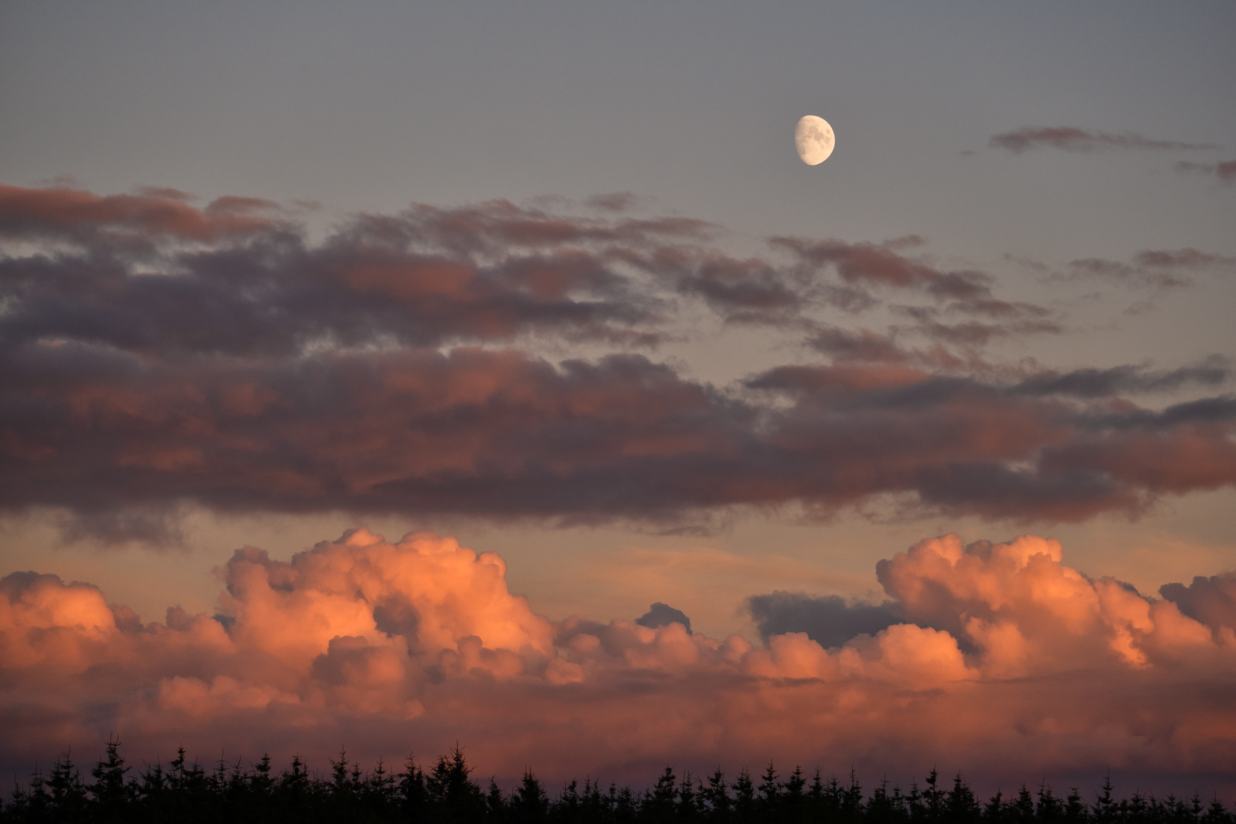 Moon, skies and clouds