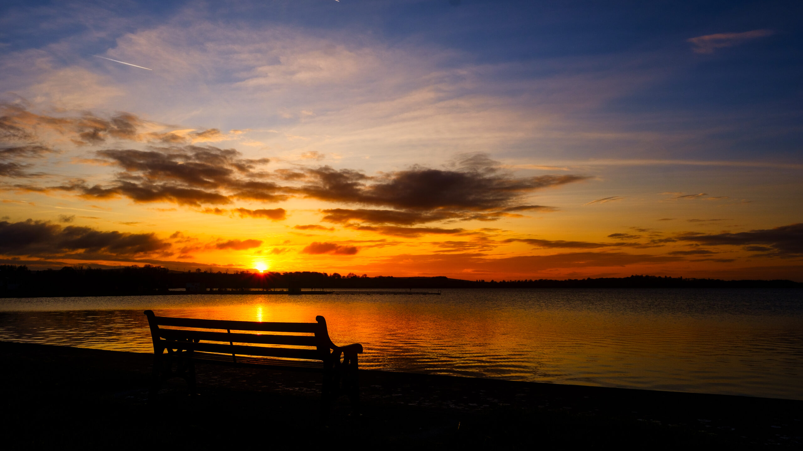 a bench at sunset Loughrea