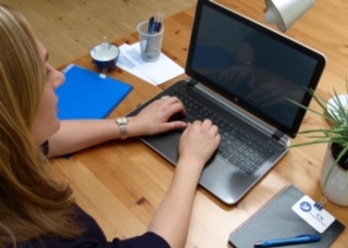 Christine Southam working on lap top at a desk