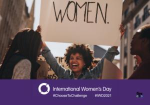 photo of woman holding card saying women