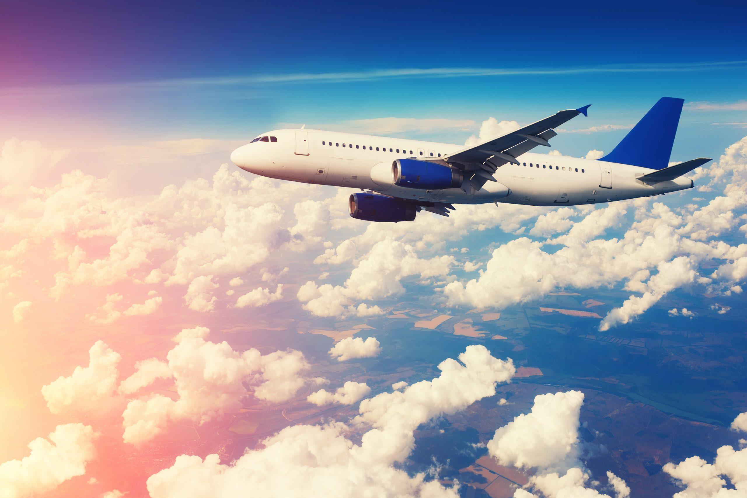 Passenger jet flying through clouds