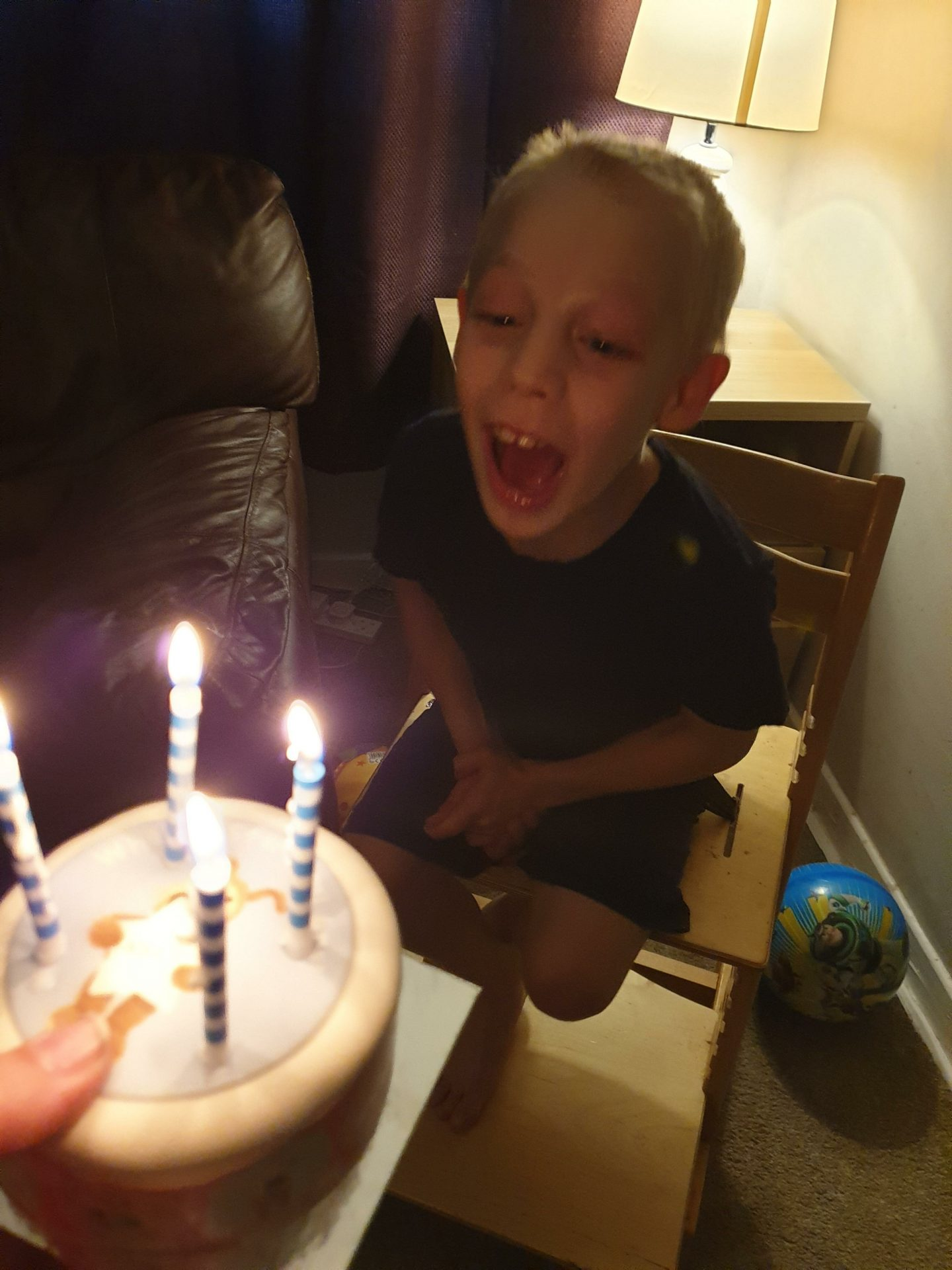 Blowing out his candles with enthusiasm
