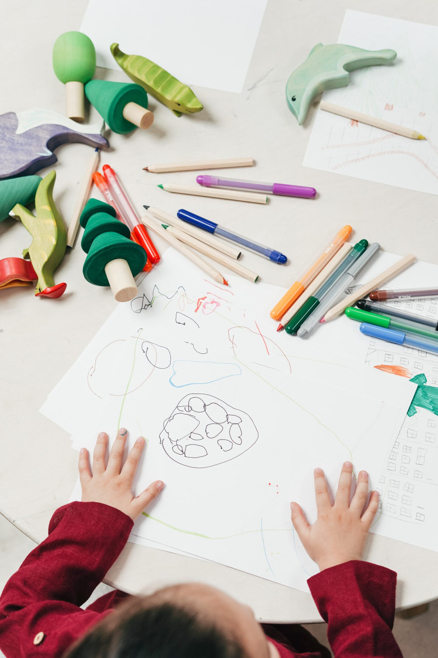 Kid painting on white table