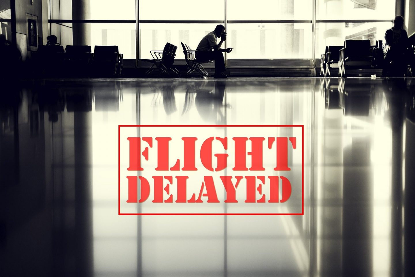 Airport with flight delayed text
