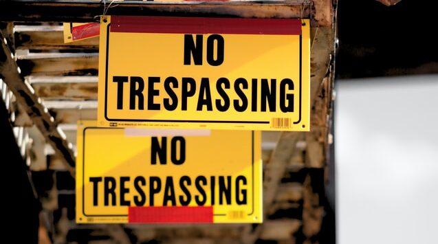 Yellow signs saying 'no trespassing'
