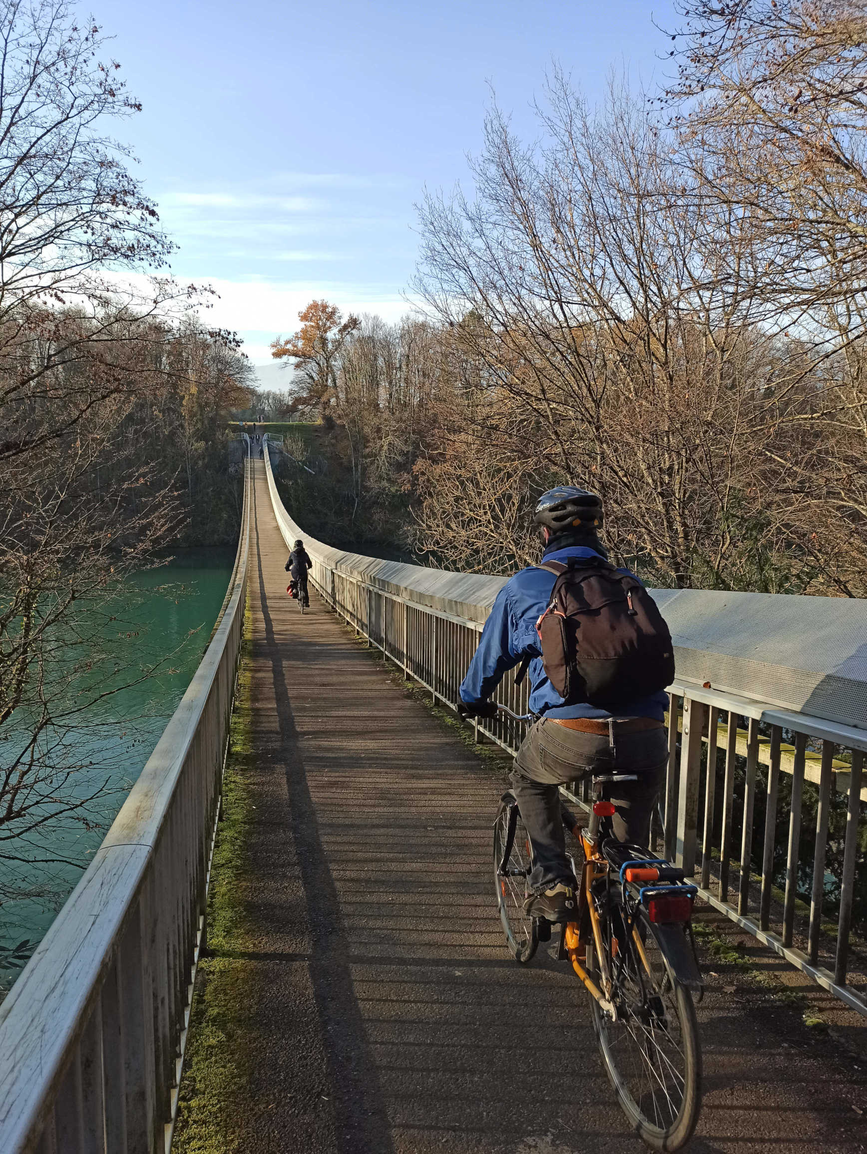 Cross the Lignon footbridge by bike