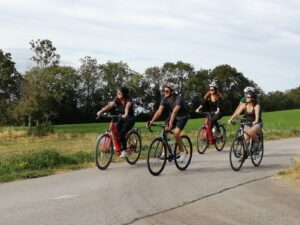 Cyclists riding a variety of types of bikes