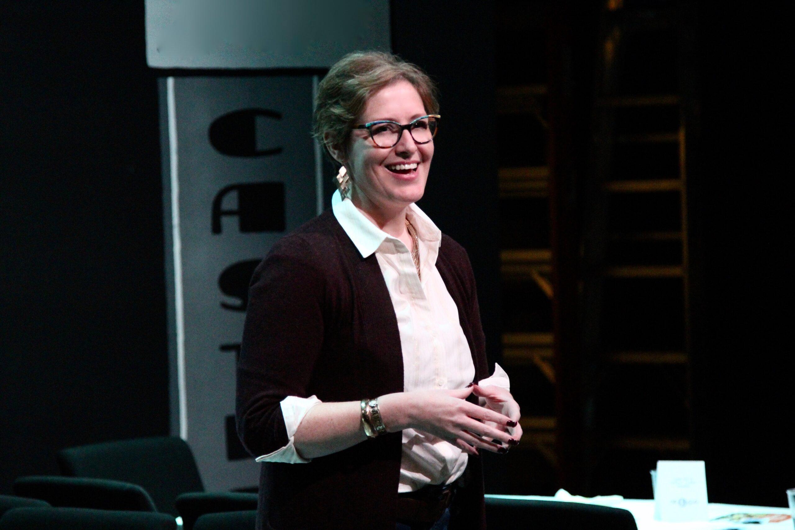 Merritt Speaking in stage lighting