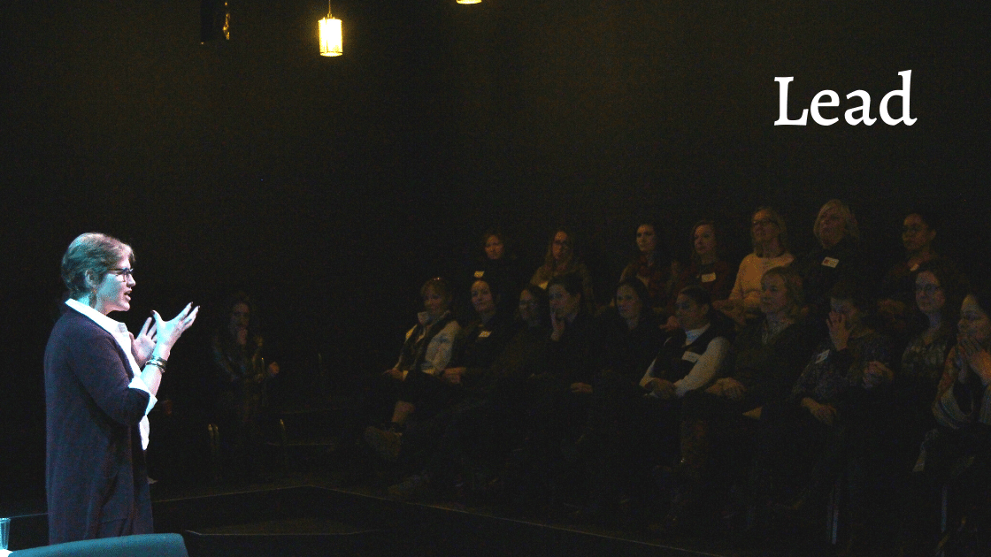 Lead Image - Merritt speaking to a crowd.