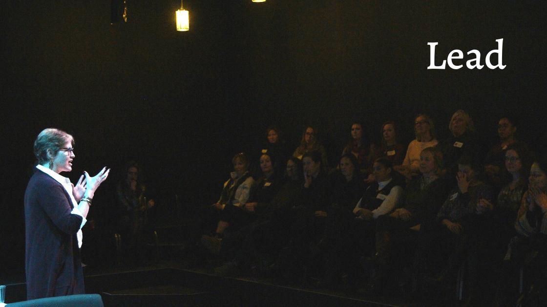 Lead Image - Merritt speaking to a crowd.