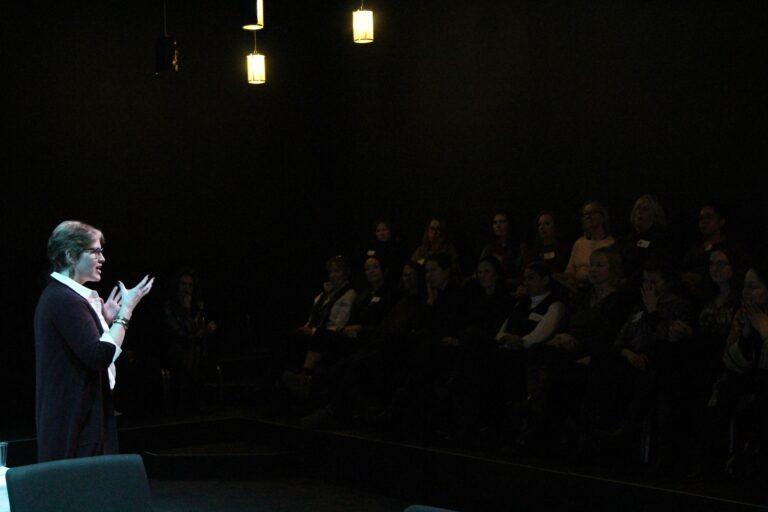 Merritt Presenting in front of group.