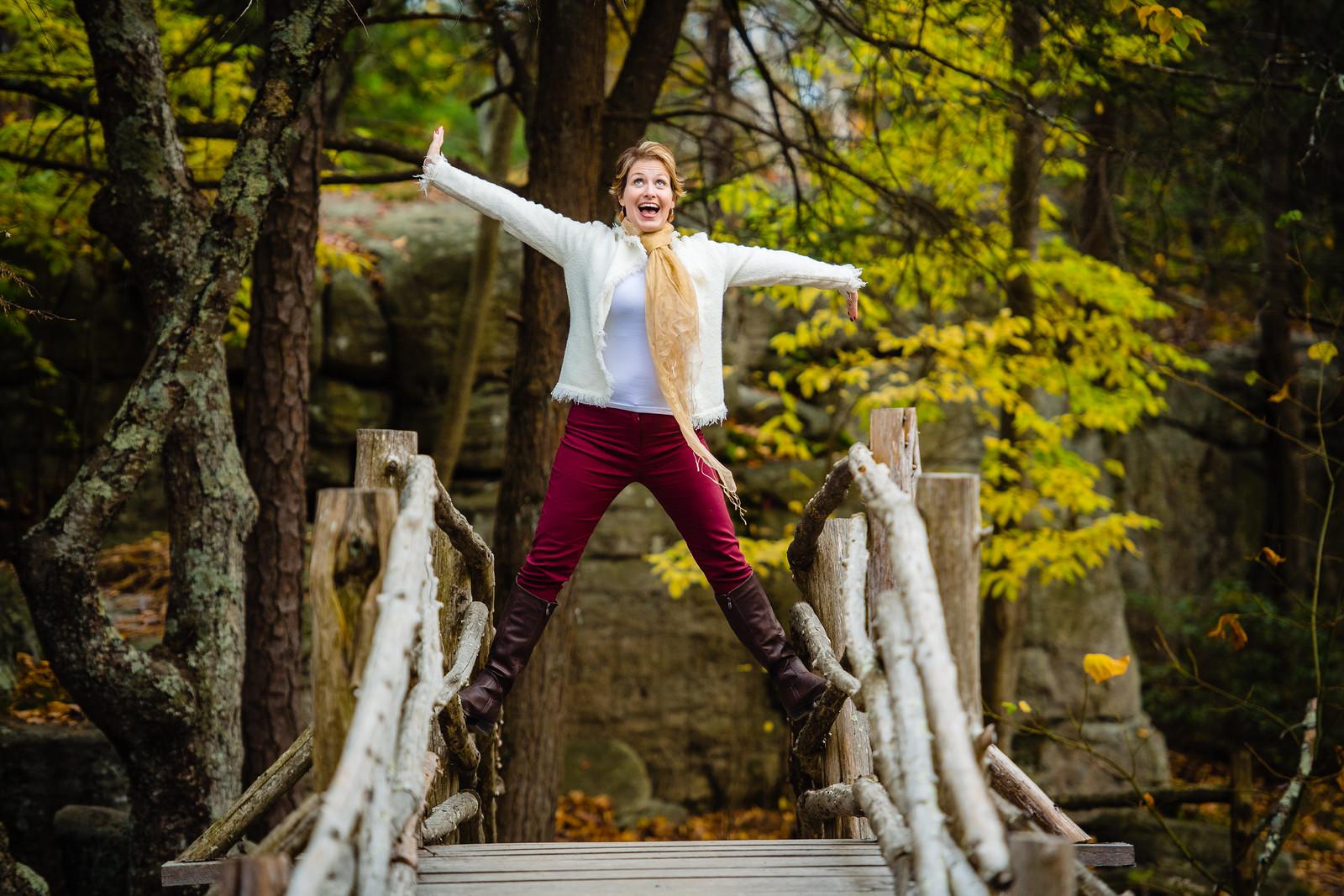 Merritt standing on bridge railings