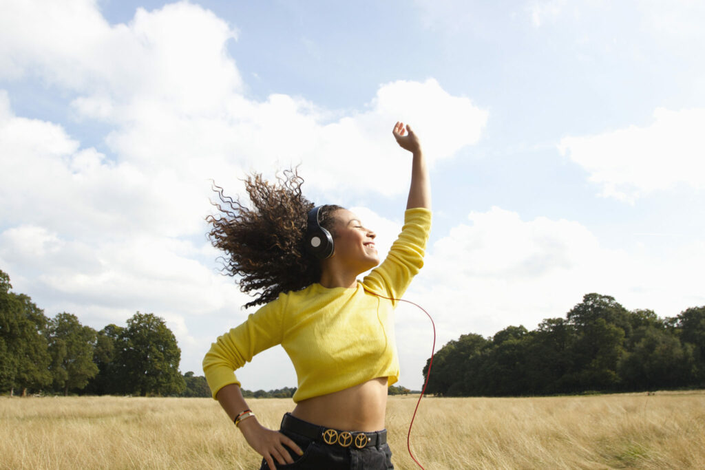 Title - Stock photo of woman dancing with happy look