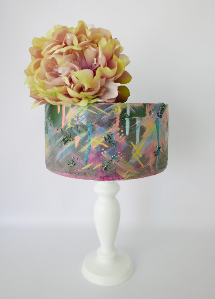 single tier art cake with cocoa butter paint splats and colour drips