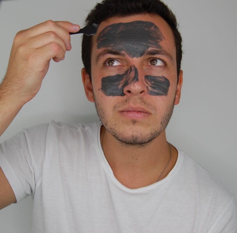 Men applying a face mask