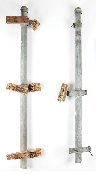 The two original metal posts from the Grassy Knoll fence, which plays a large role in conspiracy theories surrounding the assassination of President John F. Kennedy