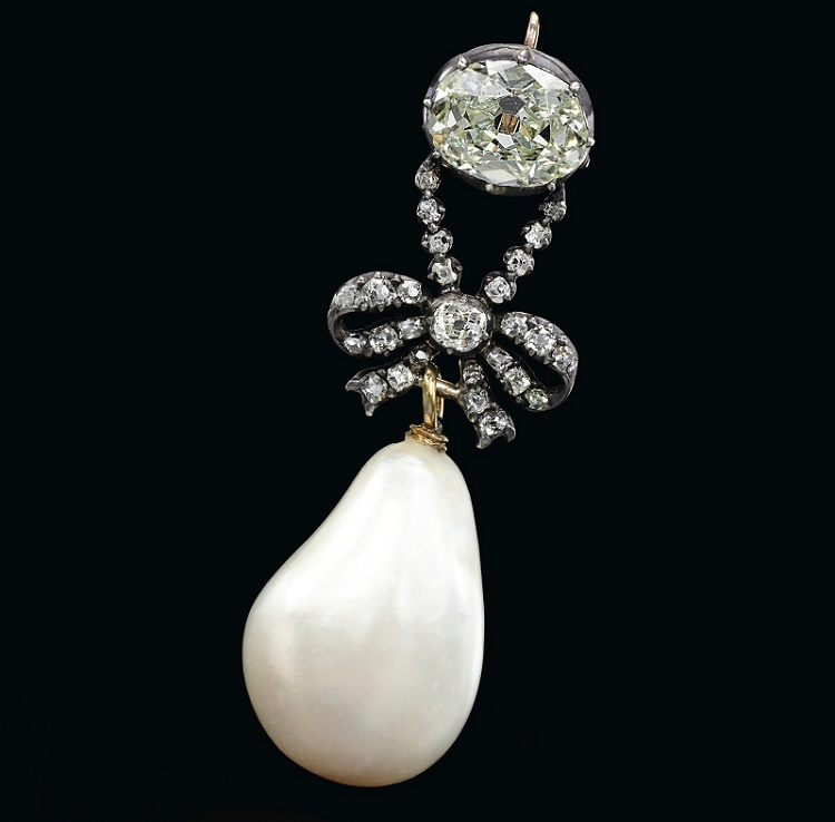 The pearl and diamond pendant sold for $36 million, more than trebling the previous auction record for a pearl jewel