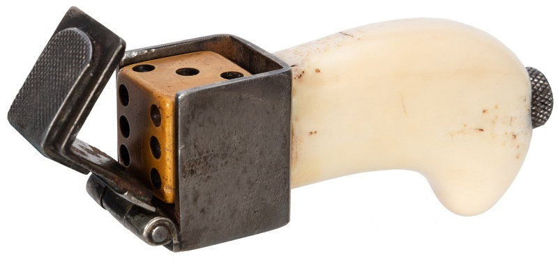 A loaded dice jig, used for drilling holes in dice and adding lead to weigh a particular side down (estimate: $1,000 - $1,500)