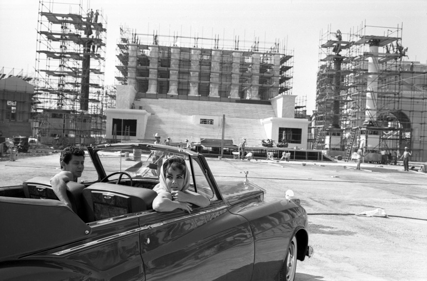 Elizabeth Taylor and Eddie Fisher arrive in the Green Goddess Rolls Royce, during construction of one of Cleopatra's epic sets