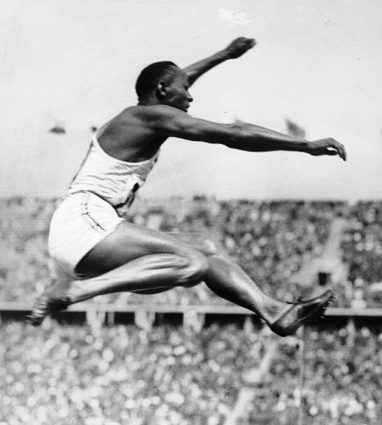 Jesse Owens photographed on his way to victory in the long-jump at the 1936 Berlin Olympic games.