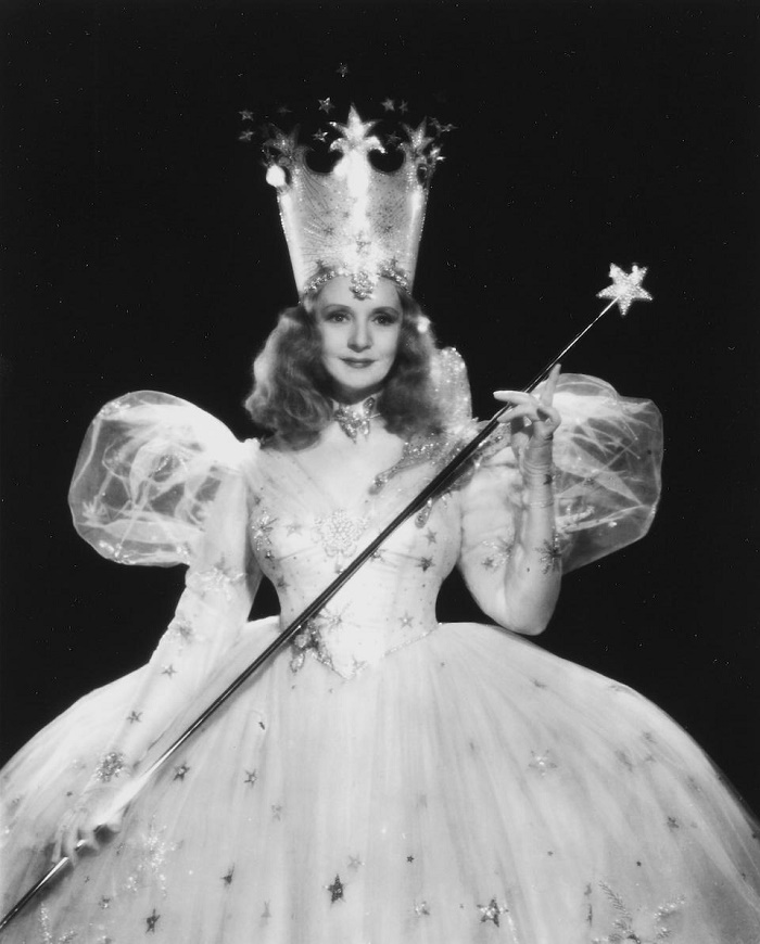 Actress Billie Burke, who played Glinda the Good Witch, holding the wand in a portrait she comissioned from MGM studio photographer Clarence Sinclair Bull (Image: Bonhams)