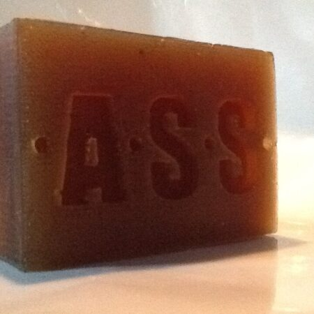 a distinctively branded, handmade bar of vegan African black soap, Dark brown in colour and weighing 130 grams.