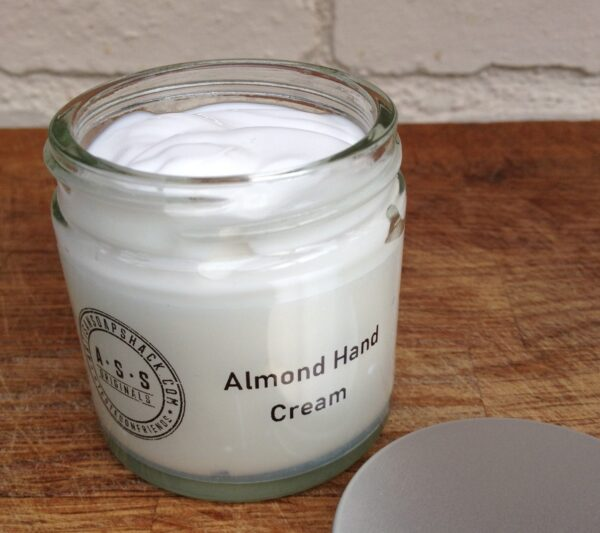 a jar of handmade, white Almond Hand Cream