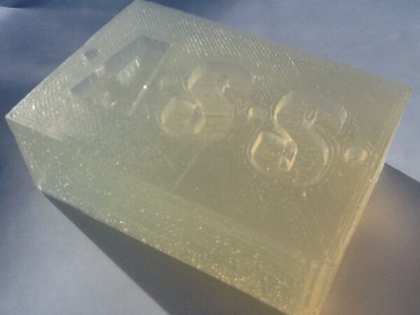 a distinctively branded, translucent handmade bar of vegan Olive Oil soap, weighing 130 grams.