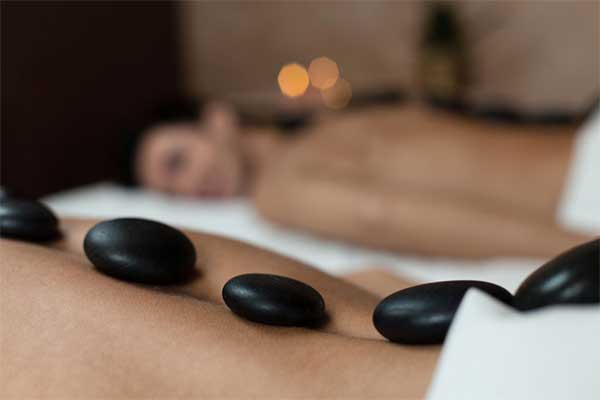 couple lying side by side during a massage