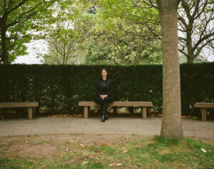 The Wick - Bettina Korek, Serpentine Chief Executive Photographed by Rosie Matheson, September 2020 in the grounds of the Serpentine Gallery, Kensington Gardens, London.   Images 20, 23, 25 include a bench which is part of a permanent commission by the Scottish poet and artist Ian Hamilton Finlay.  Installed in 1998, the work comprises eight benches, a tree-plaque, and a large, complex inscription at the Gallery's entrance.