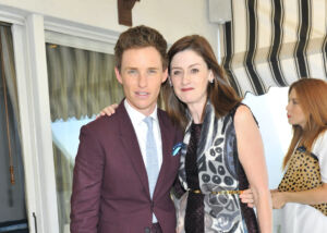 The Wick - LOS ANGELES, CA - OCTOBER 29:  Actor Eddie Redmayne and CEO of BAFTA Amanda Berry wearing Burberry at Eddie Redmayne, Vanity Fair And Burberry Celebrate BAFTA Los Angeles and the Britannia Awards at Chateau Marmont on October 29, 2014 in Los Angeles, California.  (Photo by Donato Sardella/Getty Images for Vanity Fair)